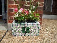 Mosaic cinder block that I made for Mother's Day.  Mom loved it - turned out very cute!