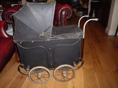 Dolls vintage pram over 100 years old, metal handle, wheels hard rubber,  padded...Addams family type pram