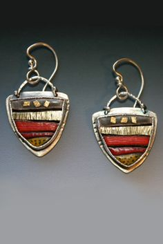 Susan Buckley creates her jewelry from sterling and fine silver, various different karats of gold, precious and semi-precious stones, and torch-fired vitreous enamels.   Each piece is created on an individual basis, so no two pieces will be identical. All the creations are hand cut, fabricated, fired, and assembled by the artist.