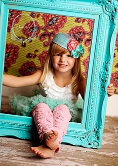 cute photo prop {gregandtashaprice}... and i would reuse the frame for her room. i LOVE that frame!