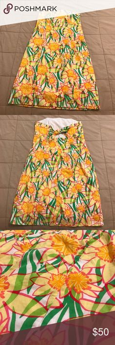 Lilly Pulitzer Daffodil Dress - Size 2 Excellent used condition! Beautiful strapless Sundress by Lilly Pulitzer. Size 2. Comes from a smoke free home.  #lilly #lillypulitzer #daffodils #strapless #sundress #summer #size2 #dress #gardenparty #pulitzer #libbyshops Lilly Pulitzer Dresses Strapless