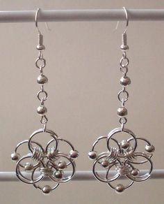 Earrings - maybe drop the bead on the flower or incorporate them differently