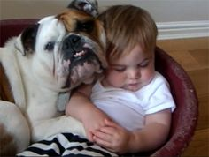 For some families baby doesn't make three -- it makes four. Check out these oh-so-cute (and pretty funny!) pictures of babies and their pets sleeping together!