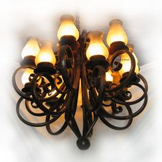 """French style iron chandelier is produced in various sizes and color options. Lamp fixture chandelier """"Portales"""" comes with rusted finishing, natural or as black iron. Candle Sconces, Wall Sconces, Portal, High Ceiling Living Room, Wall Lights, Ceiling Lights, Hacienda Style, Iron Chandeliers, Rustic Colors"""