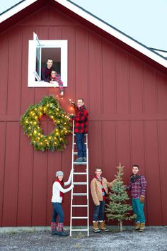 Serena and Colin Thompson get a helping hand from sons (from left) Cody, Bongo, Lucas, and Micah. The barn is painted Crabby Apple by Sherwin-Williams.