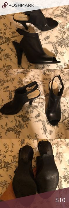Nine West heels Black Velcro strap heels. In used condition but lots of life left. Some scuffs on the heels, shown in pictures. About 3 1/2 inch heel Nine West Shoes Heels