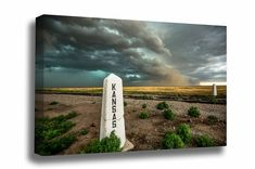 """A railroad post at the state line welcomes a storm from Colorado into Kansas. • Professional Quality Gallery Wrapped Canvas • Available in 3/4"""" or 1-1/2"""" Depths • Solid Wood Frames • Mirrored Sides • Ready to Hang Out of the Box • Multiple Sizes to Select From • Ships in Three Business Days • No Invoice Included in Shipment - Great for Gifting Western Photography, Storm Photography, Railroad Photography, Plain Canvas, Western Landscape, Wood Frames, Landscape Pictures, Wall Art Pictures, Canvas Wall Art"""