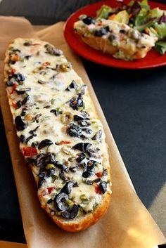 Olive Cheese Bread Recipe -- french bread, mayo, monterey jack cheese, black olives, pimiento stuffed green olives, green onions, salt & pepper.