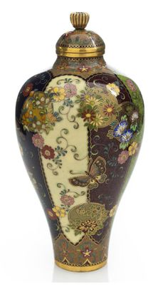 A small cloisonné enamel vase and cover By the workshop of Namikawa Yasuyuki (1845-1927), Meiji period (late 19th century) The small vase of meiping form and worked in silver and gold wire and colored enamels with scrolling floral vines, floral roundels and butterflies on vertical panels, the foot and cover decorated with bands of stylized flower heads, with a gilt-metal chrysanthemum finial, signed on s silver tablet Kyoto Namikawa