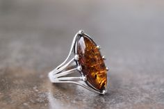 From Poland. A 'styling' little sterling silver and Baltic cognac amber ring. Amber Ring, Amber Jewelry, Gothic Jewelry, Jewelry Rings, Silver Jewelry, Boho Rings, Gold Bangles, Beautiful Rings, Sterling Silver Rings