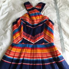 Shoshanna Multicolor Shae Cross neck striped dress Beautifully made and eye catching! Bright stripes are so in for spring and summer! Lined. NWT. 45% silk, 55% cotton. 28 inches armpit to hem. Has pockets! Shoshanna Dresses