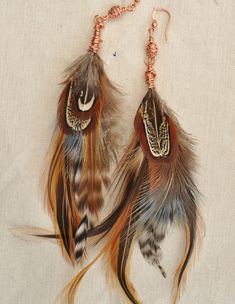copper & feathers--love love these- bought a pair of feather earring this week- so excited to wear them- the feathers are turquoise!!!