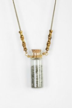 I'm pretty much a sucker for necklaces with random shit enclosed in a glass container.