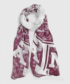 "This extra large soft and sheer rayon blend spring scarf has a beautiful maroon and white watercolor design on it. Each each is the same and reads ""Aggies, Texas A&M University"" with a large white block ATM."