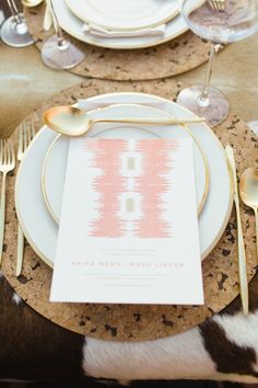 Menus add a little bohemian flair with a pretty ikat pattern  Photography: Jess Barfield Photography - jessbarfield.com Floral Design: Stems of Dallas - stemsofdallas.com Styling + Creative Direction: Lindsey Zamora - lindseyzamora.com  Read More: http://www.stylemepretty.com/2012/11/08/santa-fe-photo-shoot-from-jess-barfield-photography/