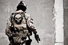 Airsoft player wearing soft body armor and a Pantac RRV or similar vest