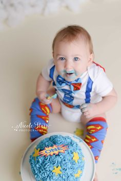 What a fun way to celebrate being one! | Superhero cake smash, blue superhero cake, first birthday, Saratoga Springs photographer, upper New York photographer