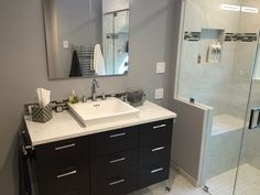 Floating Huntwood vanity cabinet with vessel sink