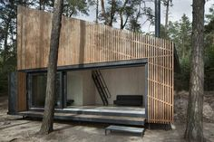 FAM Architekti completed Lake House, a tiny prefab cabin with a slatted larch facade in Czech Republic's Northern Bohemia. Prefab Cabins, Lake Cabins, Cabin Design, House Design, Lakeside View, Haus Am See, Wooden Cottage, Timber Cladding, Architecture Design