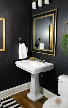 Bold yet classic bathroom makeover (black tone-on-tone matte and metallic with gold and green) - Persian Garden Damask Wallpaper Wall Stencil by Royal Design Studio - via domesticcharm