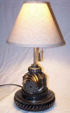 Desk lamp made from recycled car parts metals cars and lights designer and artist deron dixon is using salvaged auto parts to recreate the table lamps design working with mechanical systems and lighting deron constr mozeypictures Choice Image