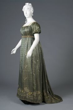 Evening Gown: ca. 1805, silk lampas, snowflake like appliqué with sequins throughout, net lace trim. KSUM 1995.017.0063