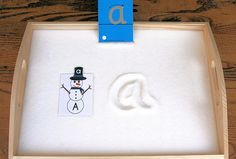 Sandpaper Letter with Snowman Letter Salt Tray/love this idea, maybe use sugar or something not o dangerous if the child decides to eat by the handful