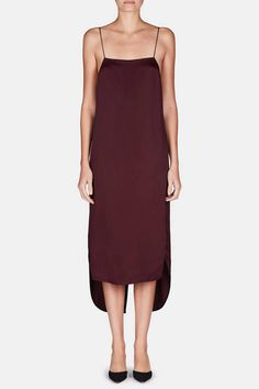 New York-based Khaite combines fluid silhouettes with exceptional Italian fabrics and inviting textures. This silky yet substantial slipdress from the resort 2017 collection is refined by delicate spaghetti straps and a curved, vented droptail hem accented with slit sides. At the notched back, a row of seven covered buttons is secured by rouleau loops. Also available in black.