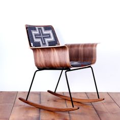 Roxy rocker   By One Forty Three. That sculpted wood is ridiculously hot.