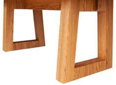 The sturdy table legs of the Delton Table in Oil & Wax Oak.