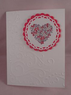Corner embossed card with flower heart