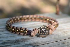 copper Leather Wrap Bracelet Single Strand Copper Rondelle Crystals Beaded with Button Clasp - Copper Rose. $23.00, via Etsy.