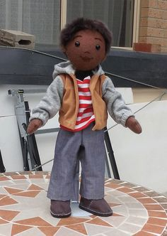 Here is Jimmy!  Jimmy is named for Jimmy Barnes and is dressed like a real Aussie kid.  He's made from 100% wool felt and has a little sheepskin wig, made from an offcut.  HIs jeans, tee, hoody and boots are made from offcuts and throwouts.