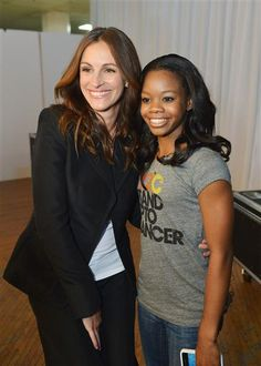 Julia Roberts and Gabby Douglas attend Stand Up To Cancer at The Shrine Auditorium in Los Angeles on Sept. 7, 2012.