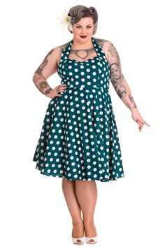 Amazing and gorgeous 60's style Polka Dot swing dress from Hell Bunny. It is superb quality vintage style dress and perfect for parties, weddings and proms. Crafted from unlined stretchy cotton with a classic polka dot print in an authentic 60's style cut. Featuring a feminine fit with a fitted zip fastening bodice with a gathered bust and and a tailored silhouette, defining curves for a killer pin-up look. The long circle skirt flares for a real retro feel and looks fabulous when worn with…