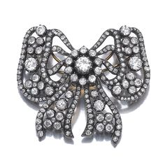 Diamond brooch, Cartier, early 20th century. Designed as an articulated tied bow, set with circular-cut and rose diamonds, mounted in yellow gold and silver.