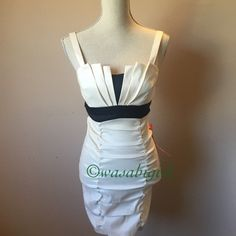 """Beautiful White Party Dress Perfect for holiday and New Years Eve parties. Very Art Deco bust design. Chest is padded so no bra necessary. Stretchy polyester/nylon/spandex blend. Bust measure unstretched about 13"""" across. Eye hook closure. Juniors Size 5. Equivalent to an XS/2 🚫No Trades Dresses"""