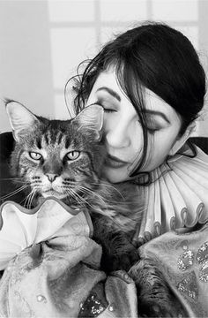 Kate Bush and her cat :-)'Cmon, angel, cmon, cmon, darling,/Lets exchange the experience, oh...