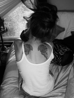 I'd like a set of angel wings like this, but closer together and it would have the words 'Faster than my angels can fly'. I'd like to think I live faster than my angels can fly