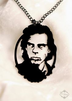 Nick Cave tribute portrait necklace in black stainless steel - music silhouette jewelry by FableAndFury on Etsy https://www.etsy.com/listing/88858349/nick-cave-tribute-portrait-necklace-in