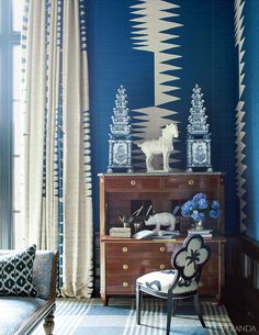 A multitude of bold patterns in complementary shades of blue induce balance. Custom sofa in Clarence House fabric. Table, J.F. Chen. Chairs, Anthropologie. Bench, John Robshaw. Walls and curtains in Kirk Brummel fabric. Rug, Elizabeth Eakins. Pillows in Penn & Fletcher fabrics. Throw, Hermes. Antique chandelier. Image originally appeared in the January/February 2012 issue of VERANDA.  INTERIOR DESIGN BY KELLI FORD AND KIRSTEN FITZGIBBONS   - Veranda.com