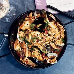 Seafood-and-Chicken Paella with Chorizo | At her restaurant, Brasa, pork-loving chef Tamara Murphy makes her own chorizo for the excellent paella on her menu. As for the seafood in the dish, she breaks with tradition by sautéing the shrimp and steaming the mussels and clams before adding them to the paella during the last few minutes of cooking; this keeps the seafood moist and delicious.