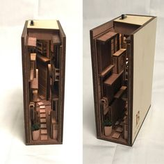Based in Tokyo, Japanese designer monde has created a new category of art and design – bookshelf dioramas. His wood inserts transform ordinary bookshelves into something magical and bring the… Tokyo, Wooden Bookends, Floating Bookshelves, Vitrine Miniature, Alleyway, Fairy Doors, Japanese Design, Japanese Artists, Book Nooks