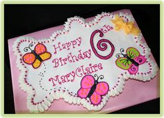 Butterfly decorations on sheet cake