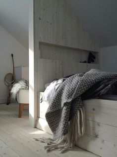 soft grey throw and bed head nook