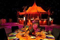 Purple napkins popped against orange tablecloths.