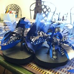 Flip flops I made! Total of 48 ribbons! Ribbon strips are 7 inches long and 12 go on each side of the sandal:) I added tool for some cuteness:)