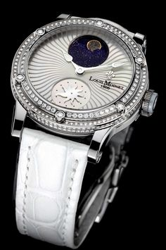 Stardance - Limited Editions - Louis Moinet | Stardance features a spectacular moon phase created from a finely-crafted fragment of the Enstatite EH3 meteorite. Surrounded by an aventurine night sky, the fragment of meteorite represents the moon, making this horological complication especially dazzling and also making Stardance the first watch in the world to contain interstellar diamonds.