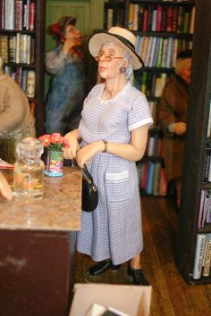 Good Sam Showcase of Miniatures: At the Show - Exhibits. Lady visiting the Book Nook. Doll by Sharon Cariola.