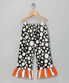 Designed with a fun and festive mix of prints and ruffle cuffs, these pants embrace the stylish side of our favorite spooky holiday. Made in soft cotton with an elastic waistband, they're perfect for glamour ghouls on the go.